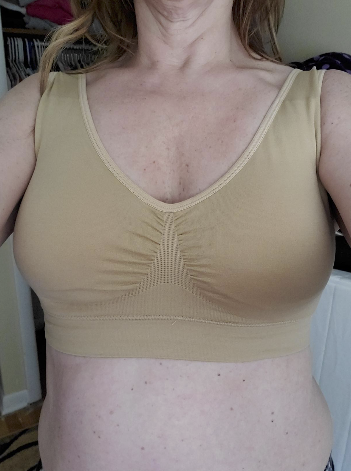 Reviewer in the beige sports bra