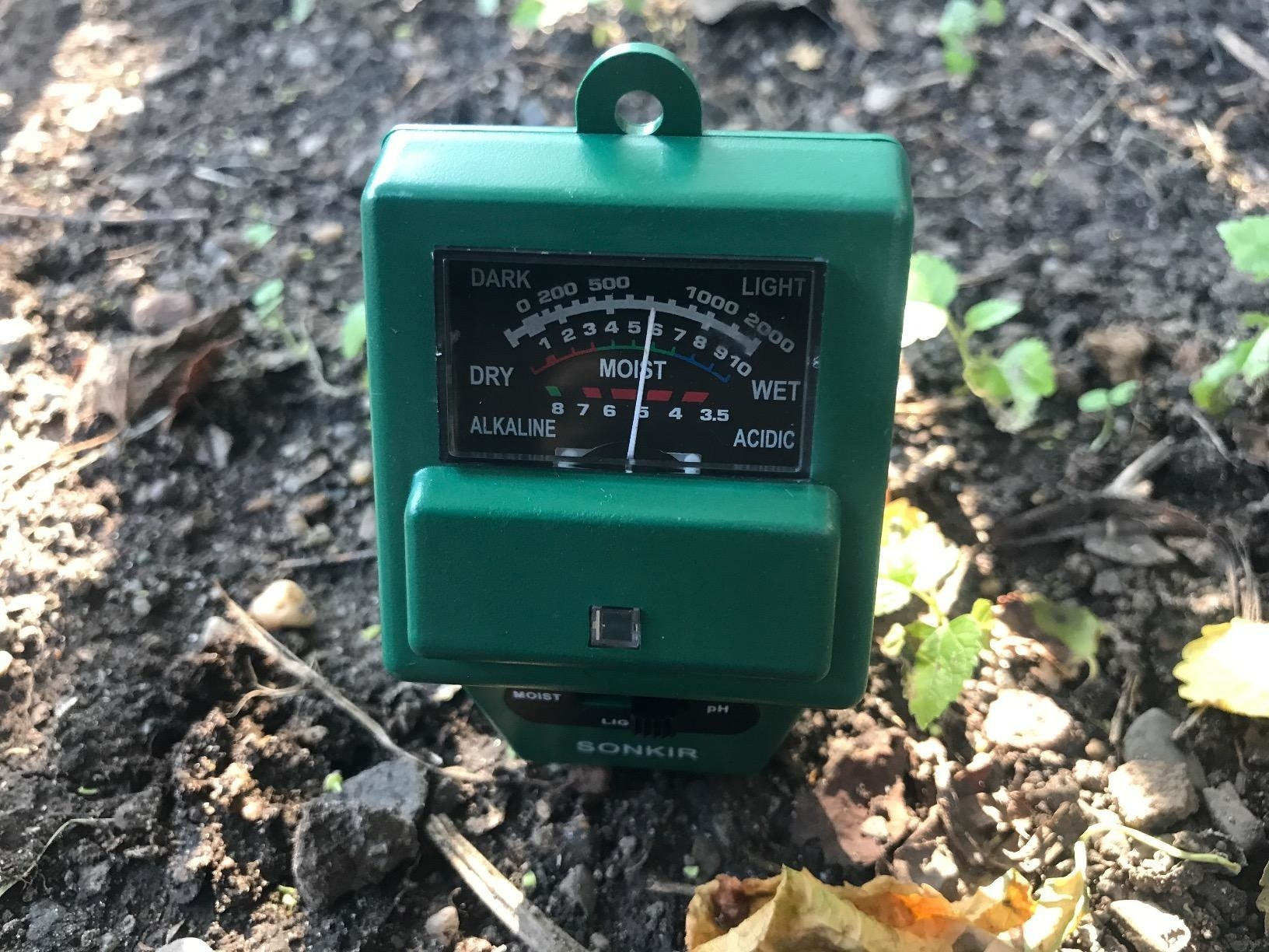 The meter sitting in the dirt