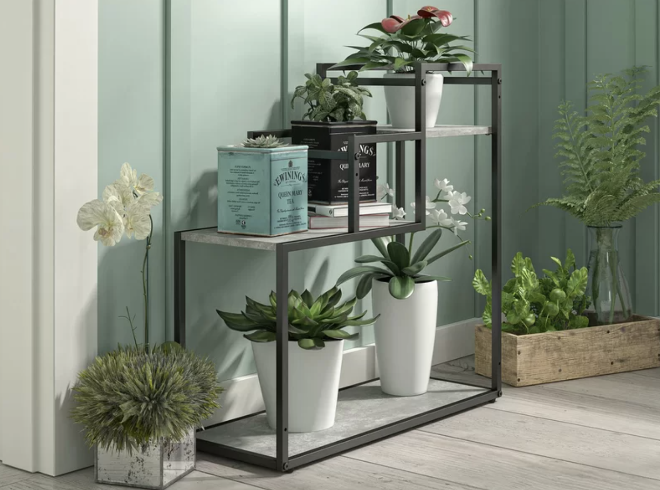A multi-tiered plant stand with succulents, flowers, and more greenery