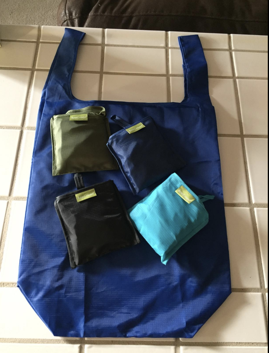 A reviewer image of one of the bags laid out with four other bags still folded into small squares