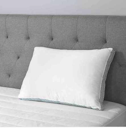the pillow propped up against a headboard
