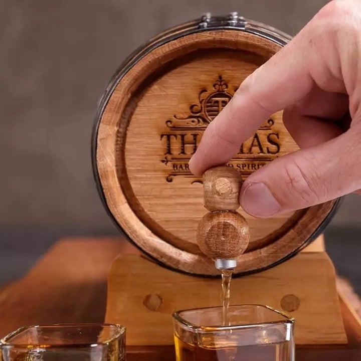 A mini whiskey barrel with a pouring stopper