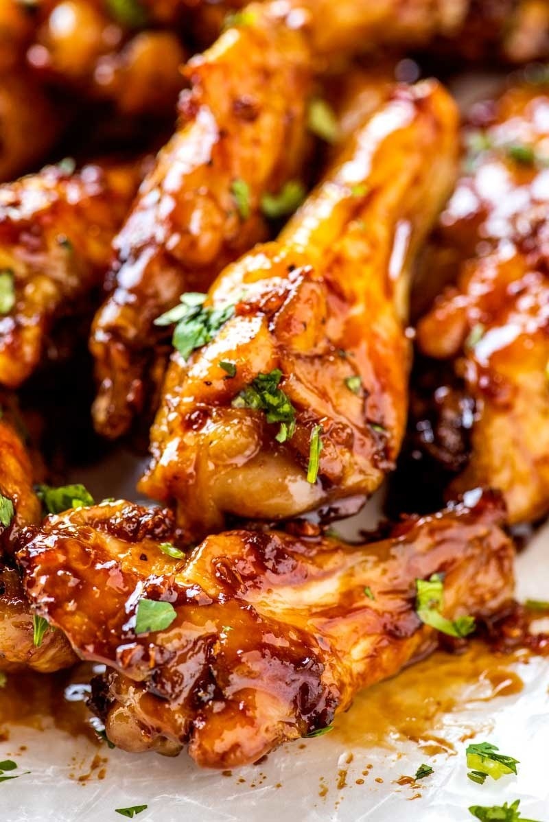 A plate of sticky, glazed chicken wings.