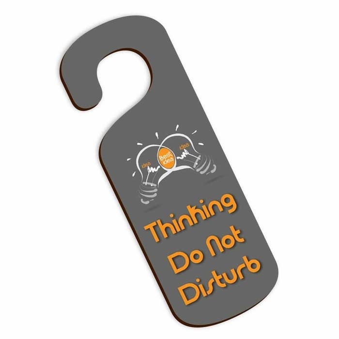"""A door knob sign that says """"Thinking. Do not disturb"""""""