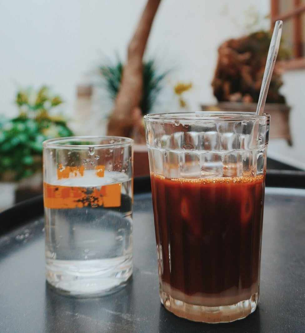 glass of water and glass of coffee