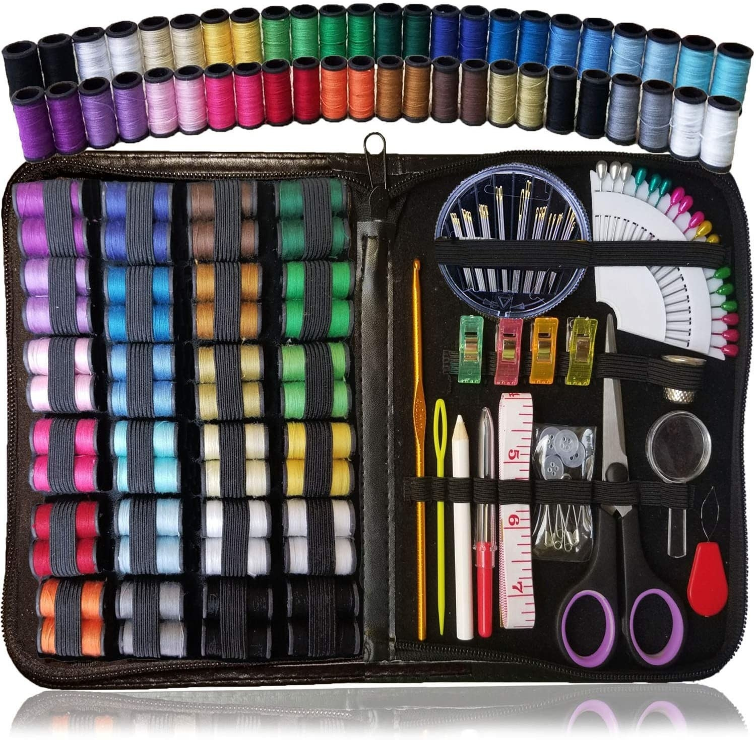 The sewing kit is laid open to show all the threads, pins, scissors, needles, and clips included