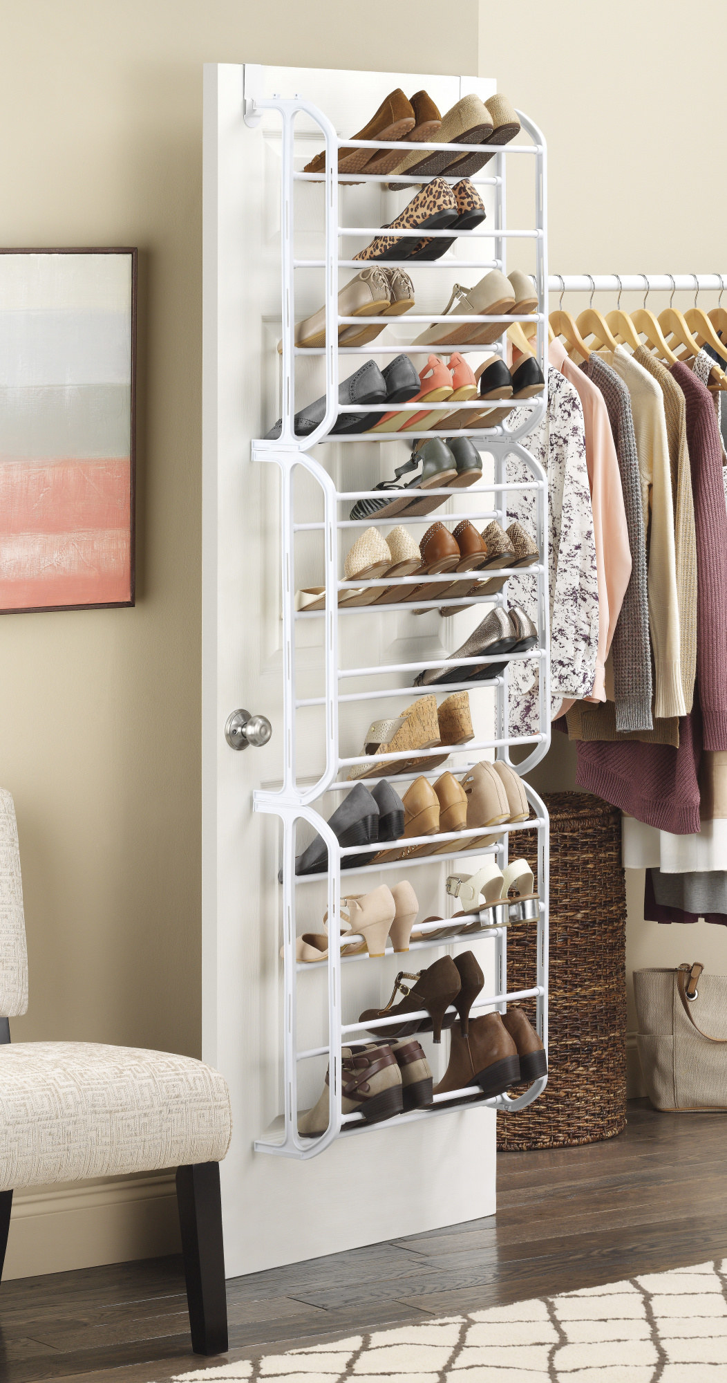 The rack in a neutral white finish, featuring wide hanging hooks and 12 shelves