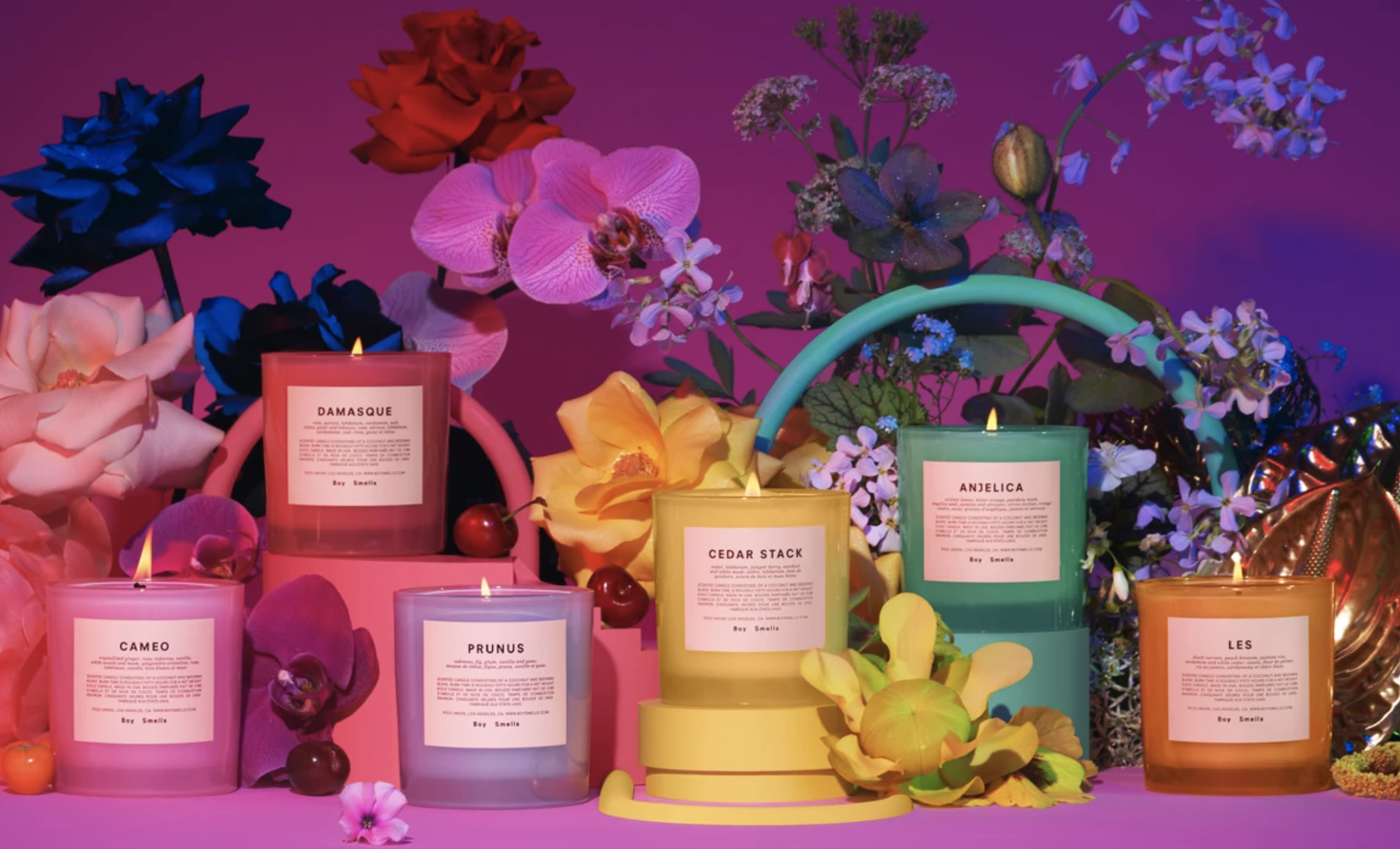 Boy Smells' Pride candle collection featuring six colorful candles, all with different scents