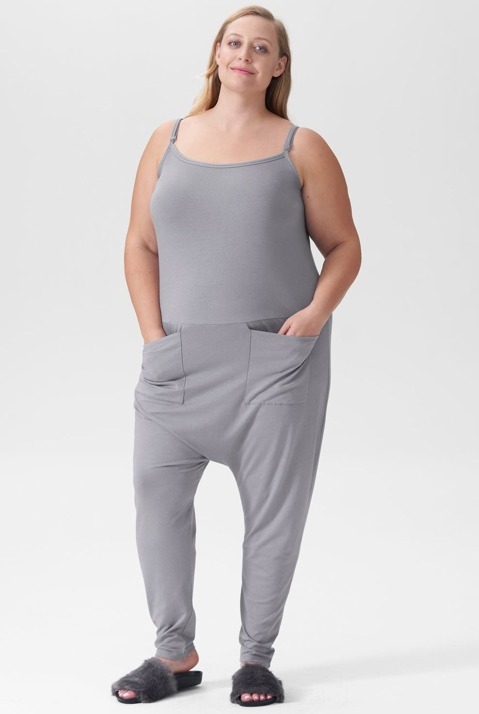 model in grey jumpsuit with hands in two large front pockets
