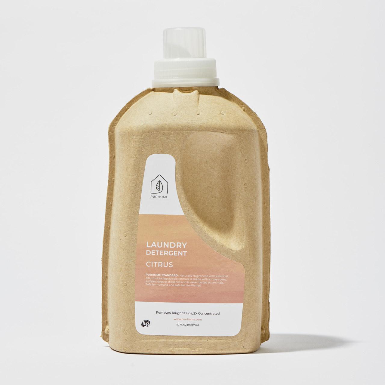 A paper bottle with citrus laundry detergent