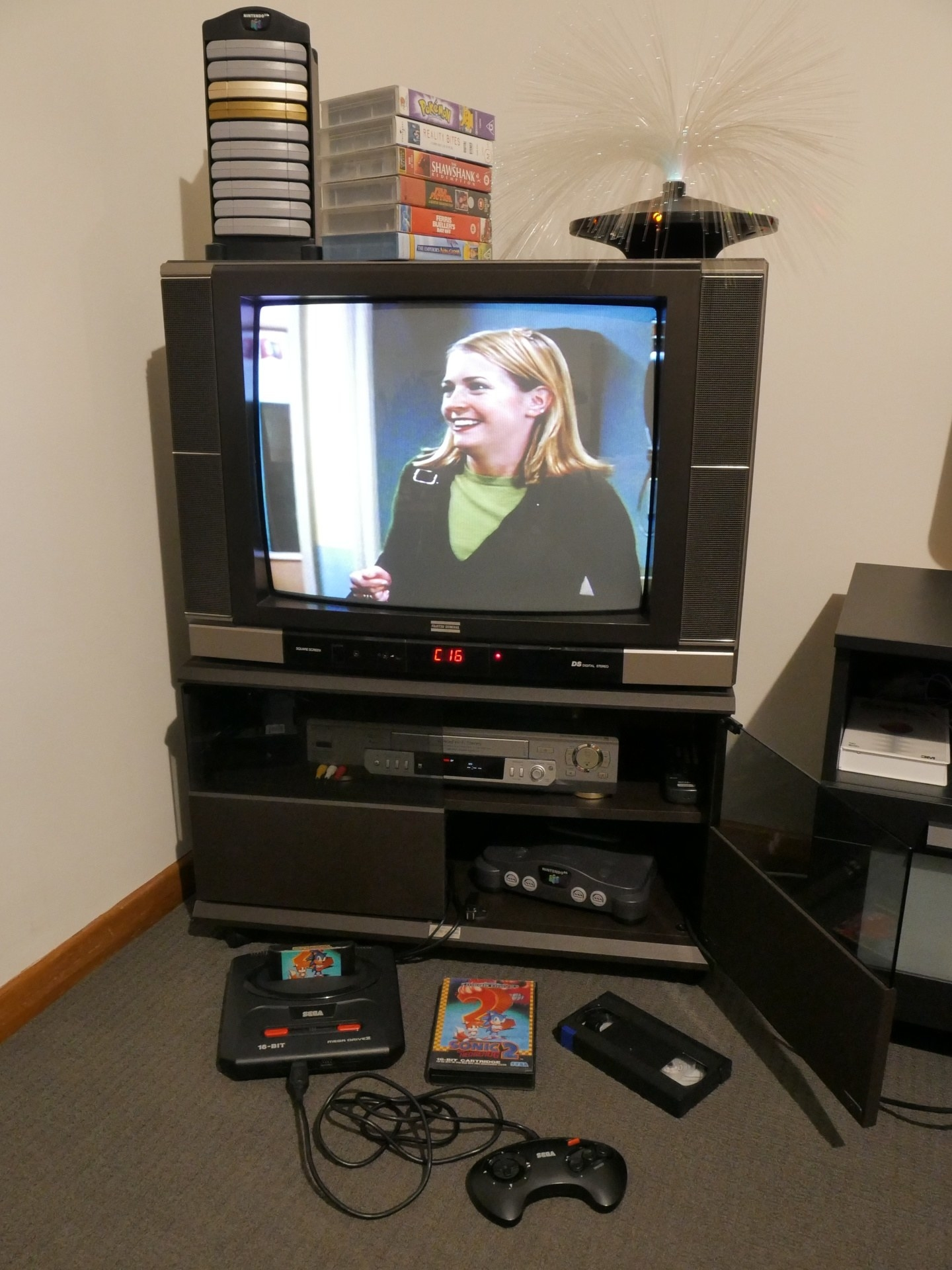 TV on cabinet with an old '90s TV on it and playing Sabrina the Teenage Witch