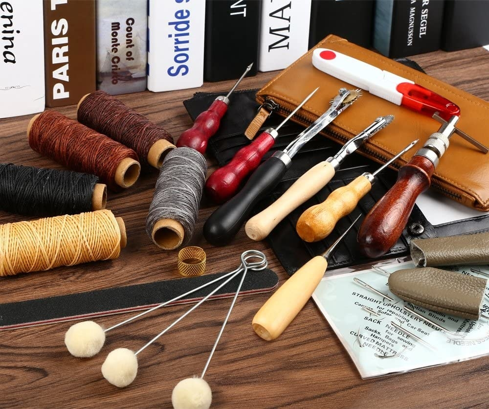 A shot of several tools, threads, and files included in the kit