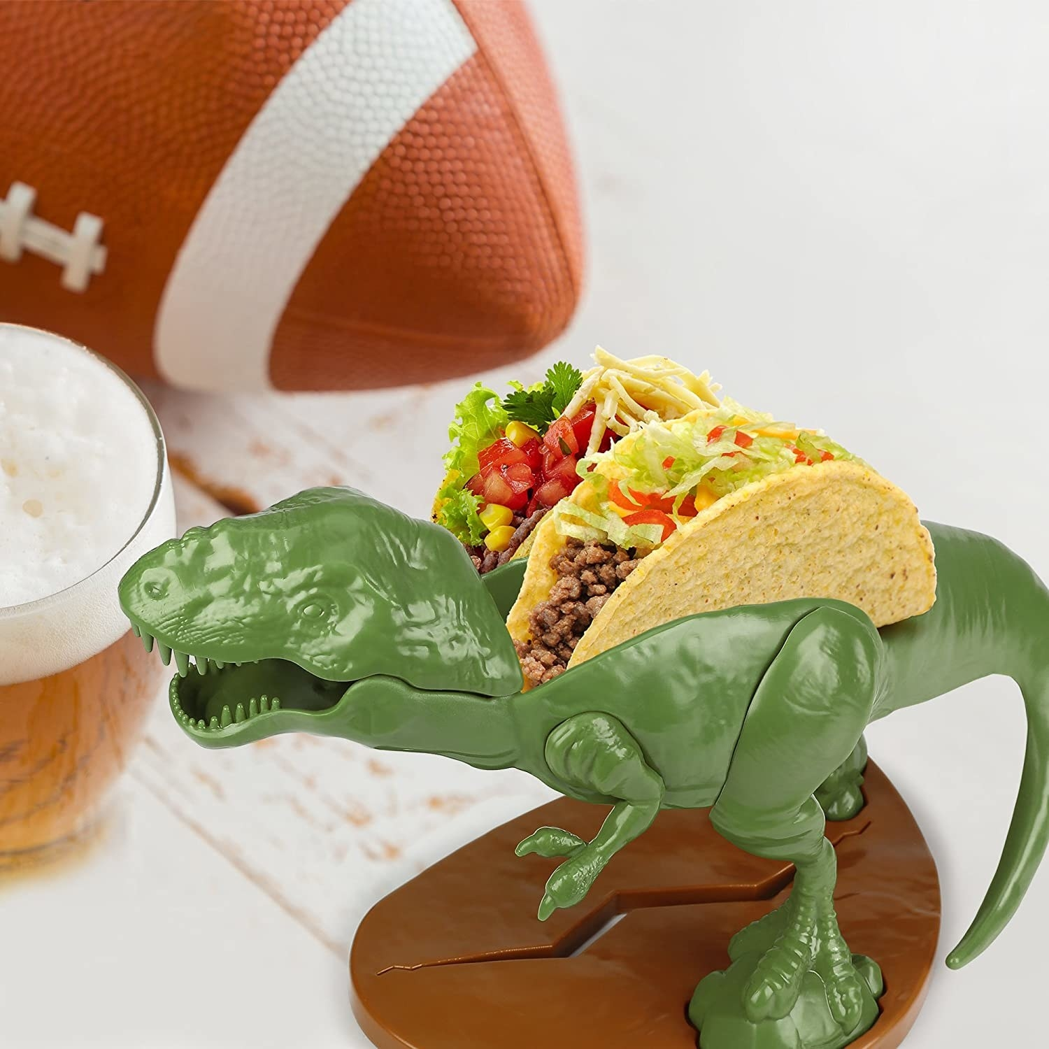 Two tacos placed on top of a T-Rex shaped toy