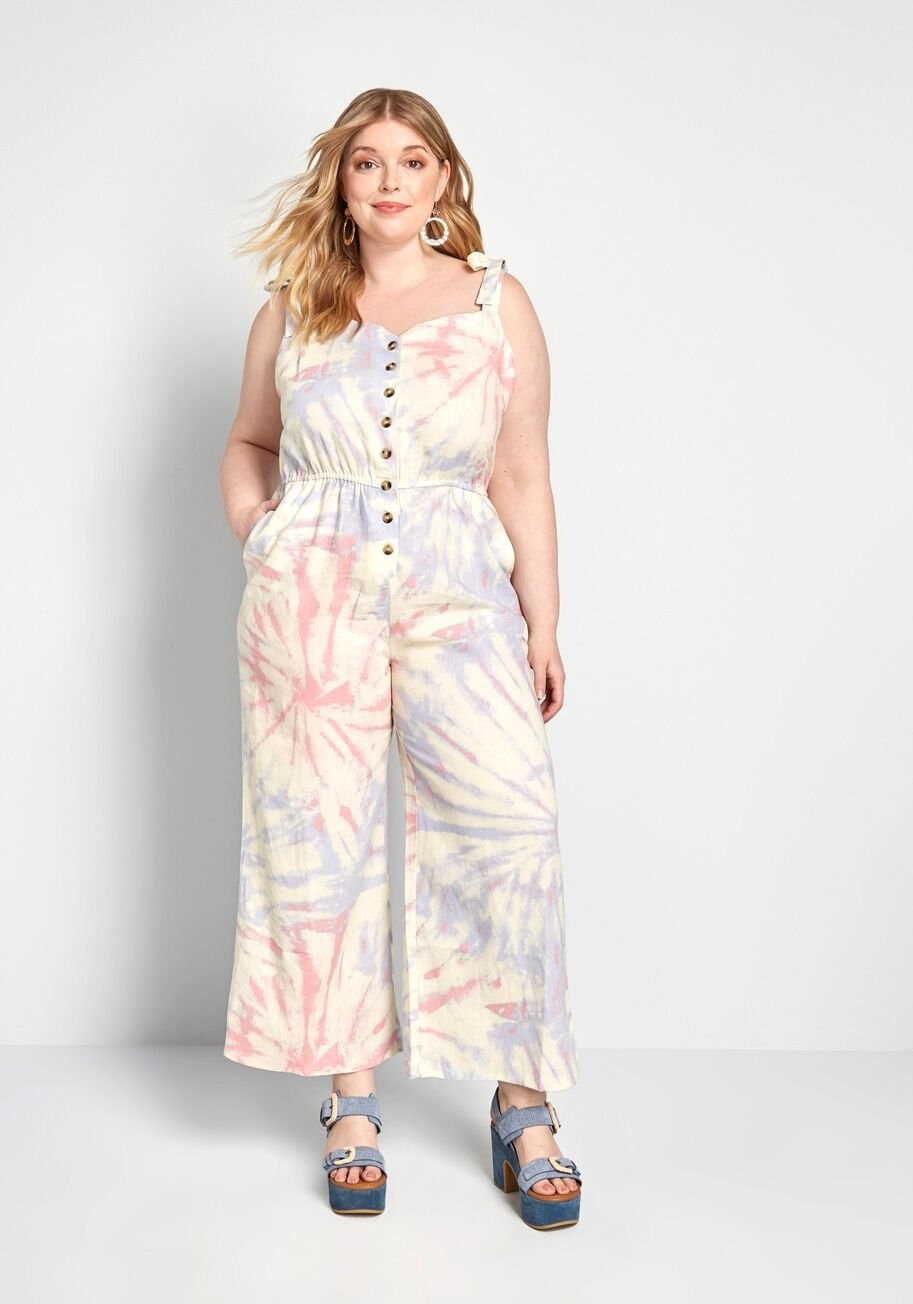 Model wearing jumpsuit that hits right above the ankles and features pockets