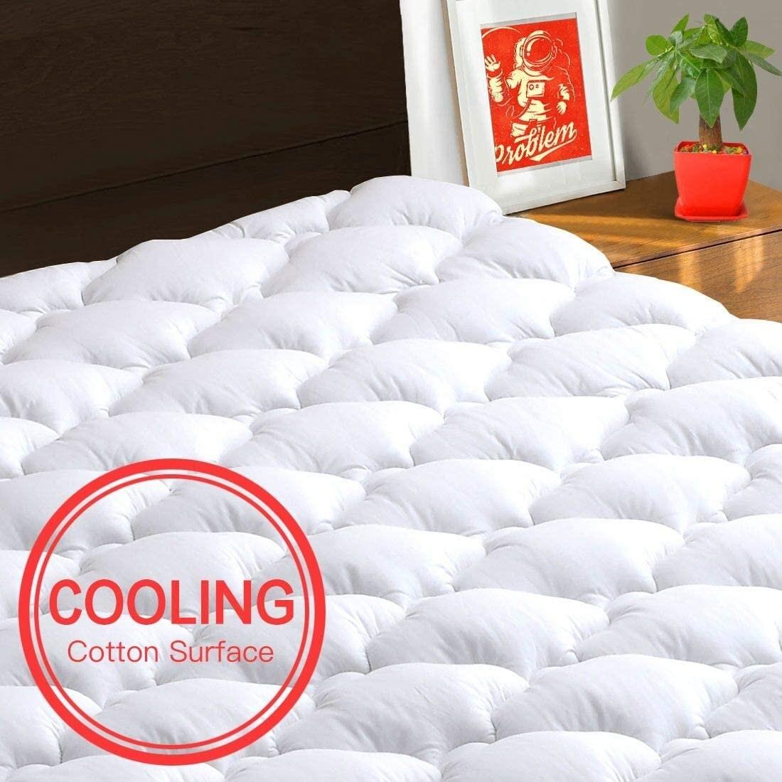 A mattress covered by the TEXARTIST Mattress Pad
