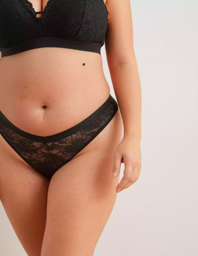 A model wearing the thong in black