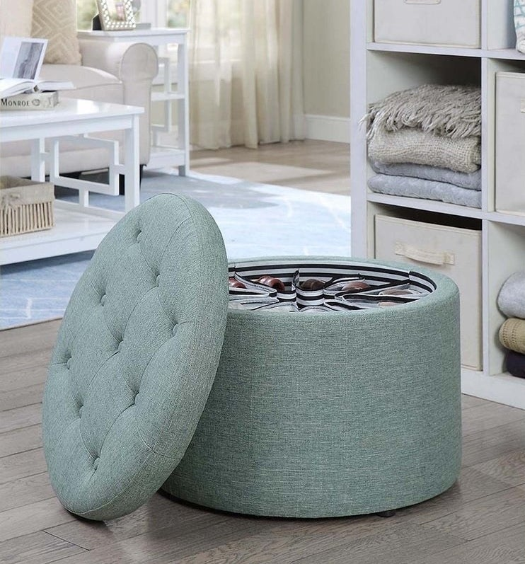 The tufted ottoman in a green fabric