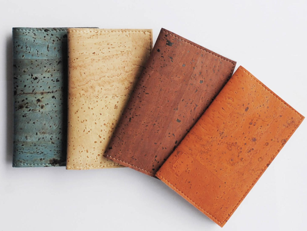 Small cardholders in dark teal, sand, maroon, and burnt orange colors