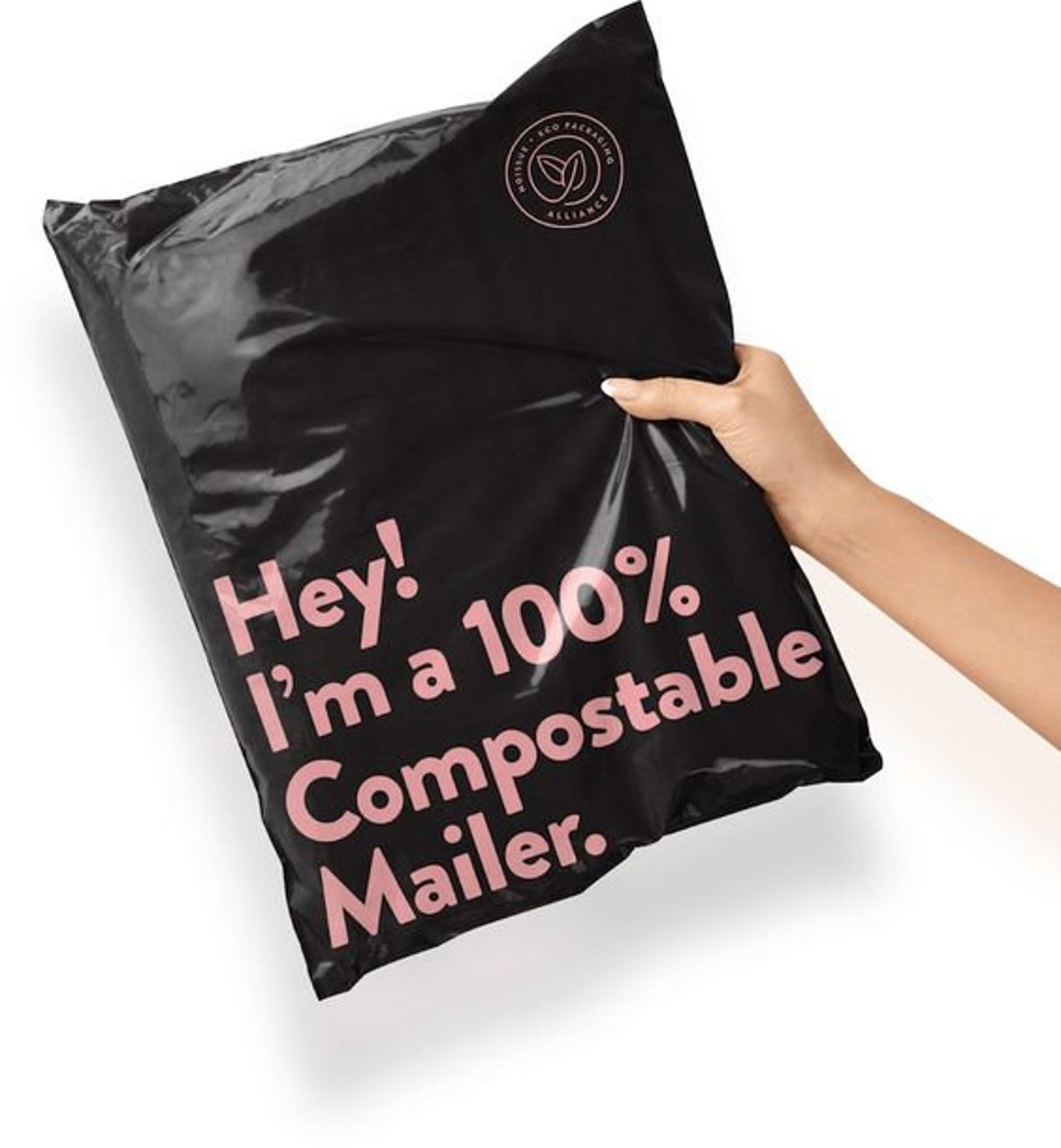"A mailer that says ""Hey! I'm a 100% Compostable Mailer"" on the front"