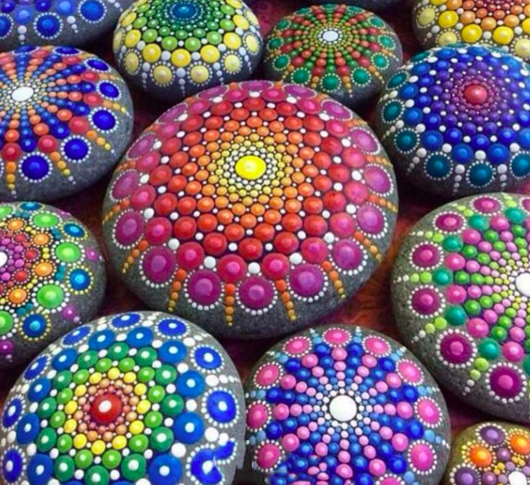 Several multi-colored painted rocks