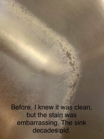 A reviewer's sink with stains along the inner edges, with the text