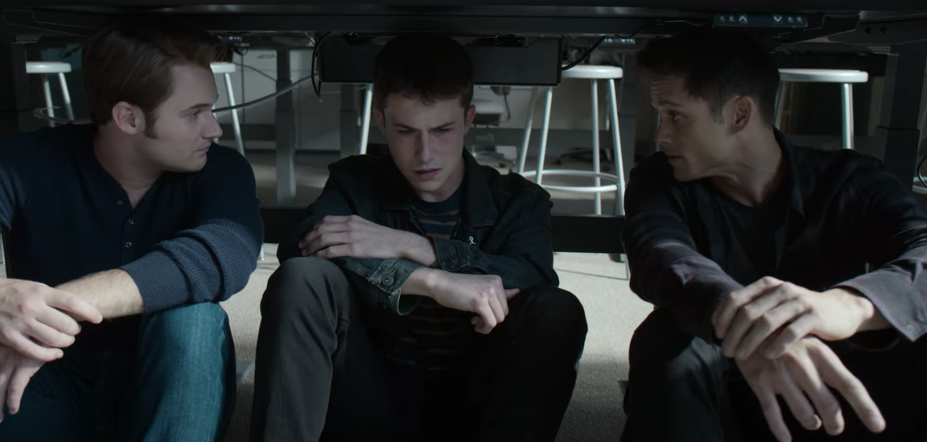 "Justin Prentice, Dylan Minnette, and Timothy Granaderos as Bryce, Clay, and Monty in ""13 Reasons Why"" hiding underneath a table"
