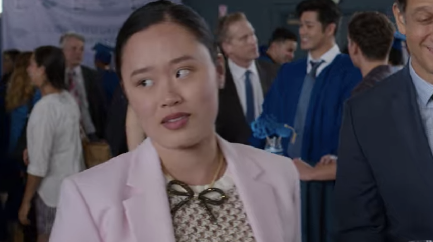 "Michele Selene Ang as Courtney in ""13 Reasons Why"" attending graduation"