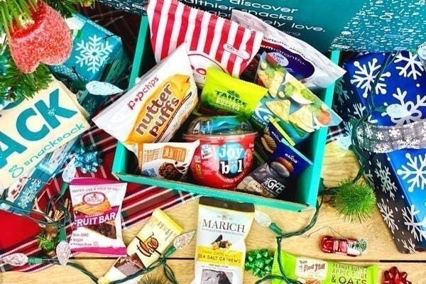 An assortment of snacks like popcorn, cashews, and granola bars