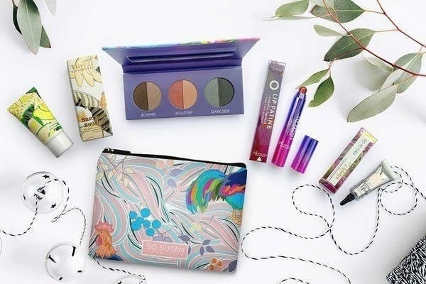 Various makeup products and a colorful makeup pouch