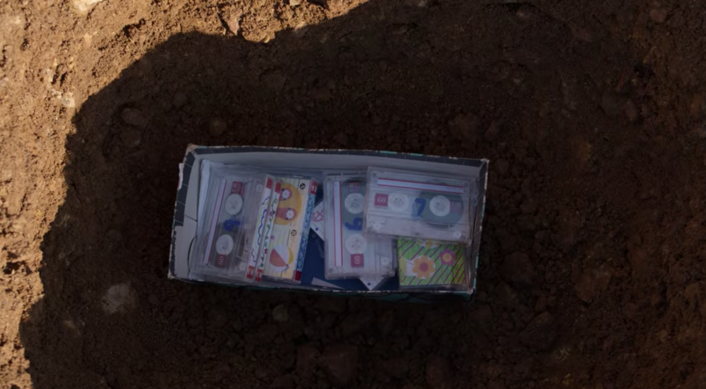 A box of Hannah Baker's original tapes at the bottom of a hole