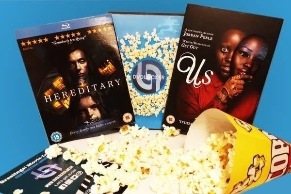 """the movies """"Us"""" and """"Hereditary"""" with popcorn"""