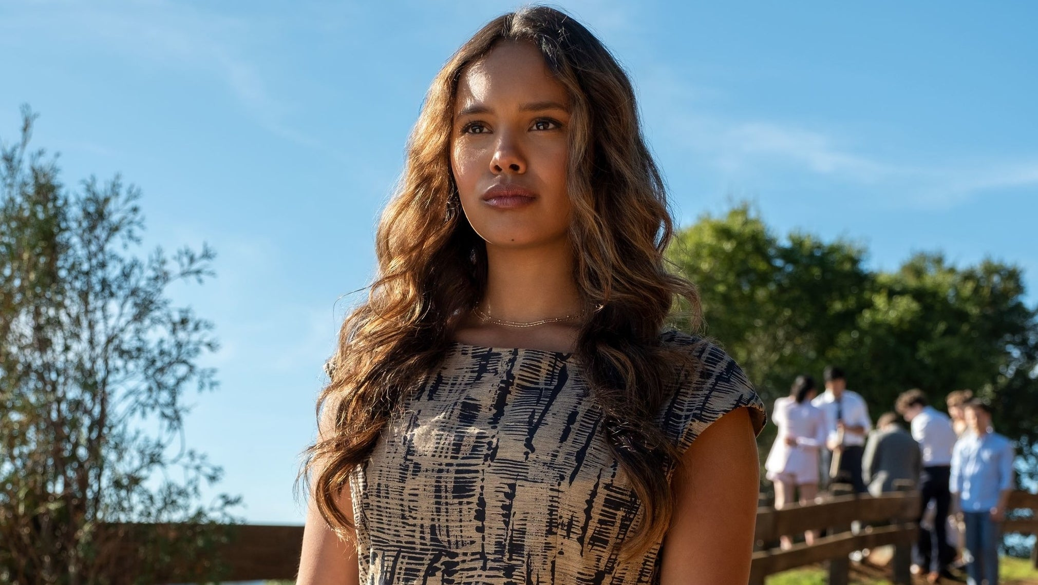 "Alisha Boe as Jessica in ""13 Reasons Why"" standing on a hill with her friends"