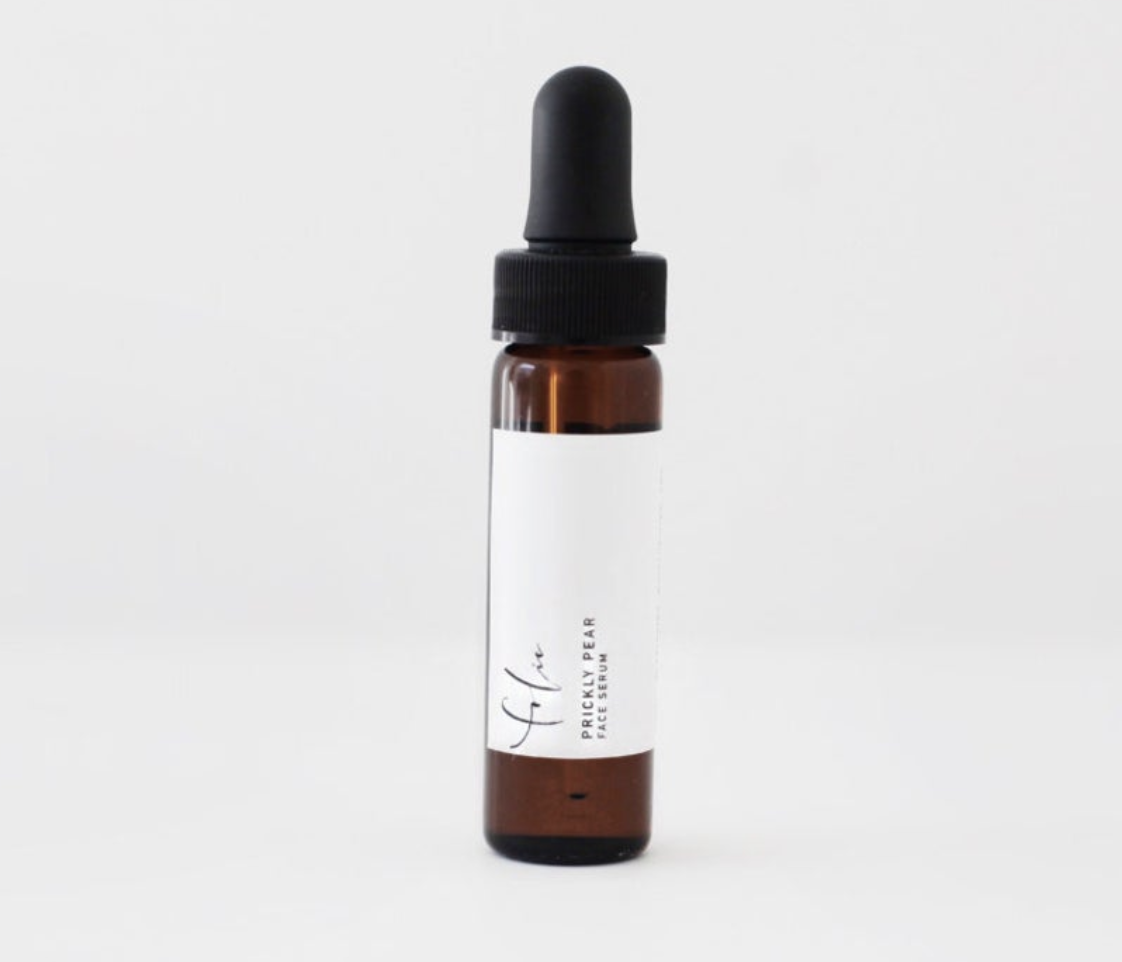 "A brown bottle with a dropper that says ""Folie Apothecary Prickly Pear Face Serum"""