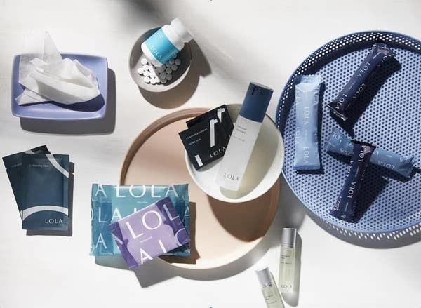 Different Lola products including pads, tampons, liners, and cleansing wipes
