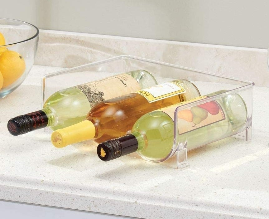 plastic container holding three bottles of wine