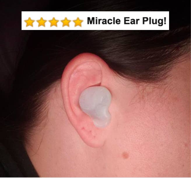 "Reviewer wearing the silicone ear plugs with five-star caption that says ""miracle ear plugs"""