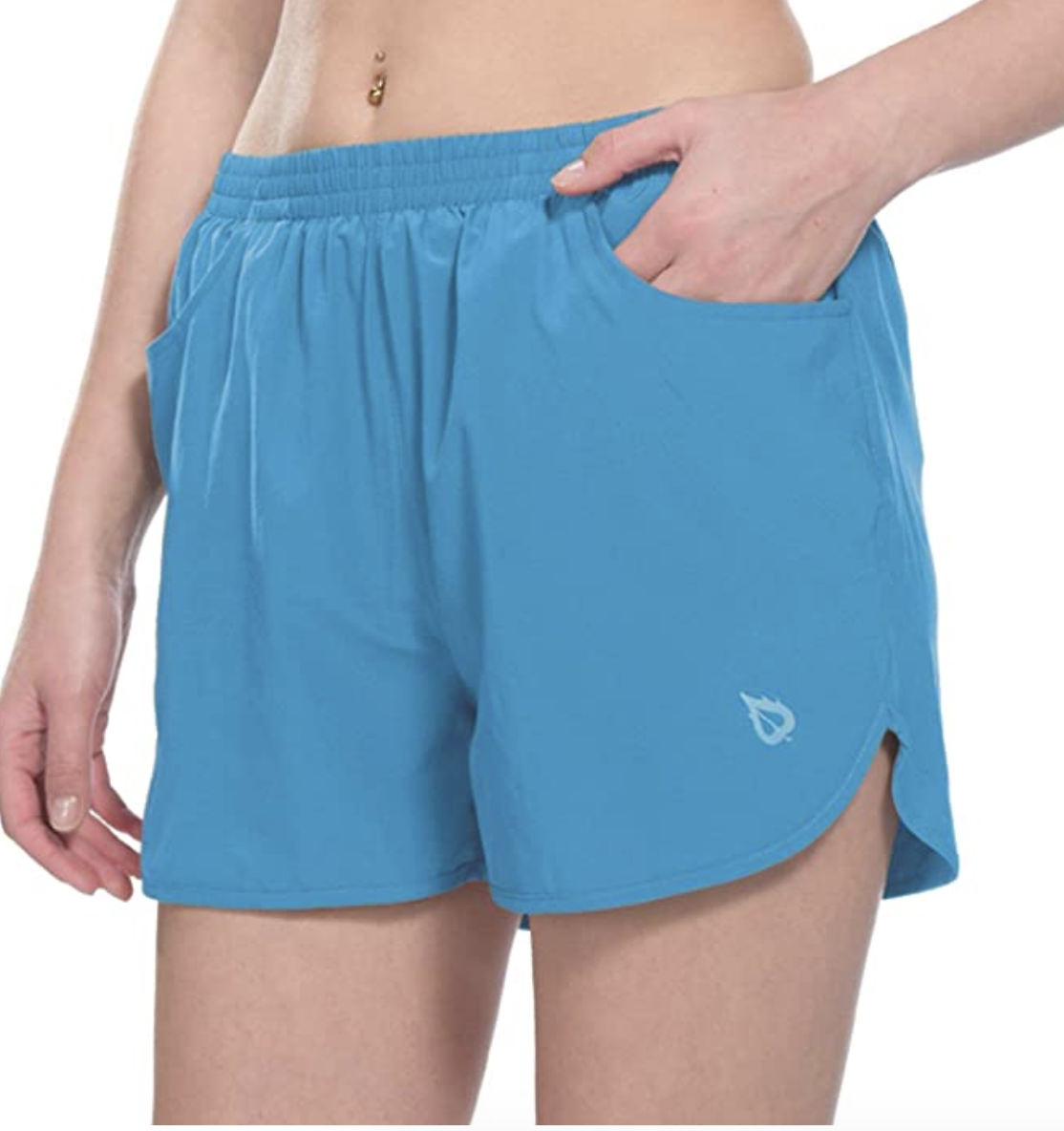 A model in blue running shorts with an elastic waist, pockets, and a hem that falls above mid-thigh