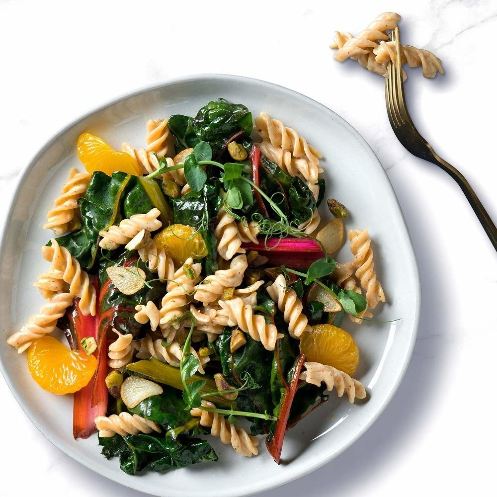 a stock photo of the rotini pasta cooked with spinach, mandarin and rhubarb