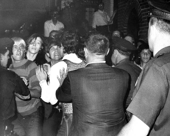 Queer Stonewall rioters keeping police officers at bay in 1969