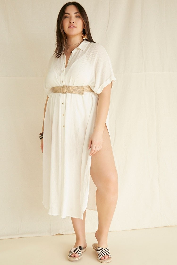 Plus-size model wearing the dress in cream with a rattan belt