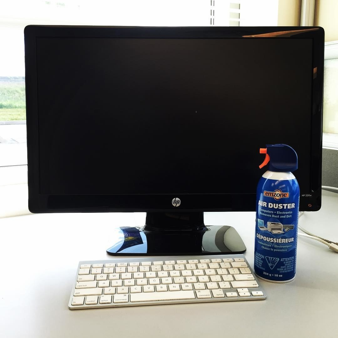 The air duster canister sits next to a keyboard