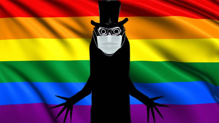 Gay icon, the Babadook, wearing a face mask while celebrating Pride Month in front of the pride flag