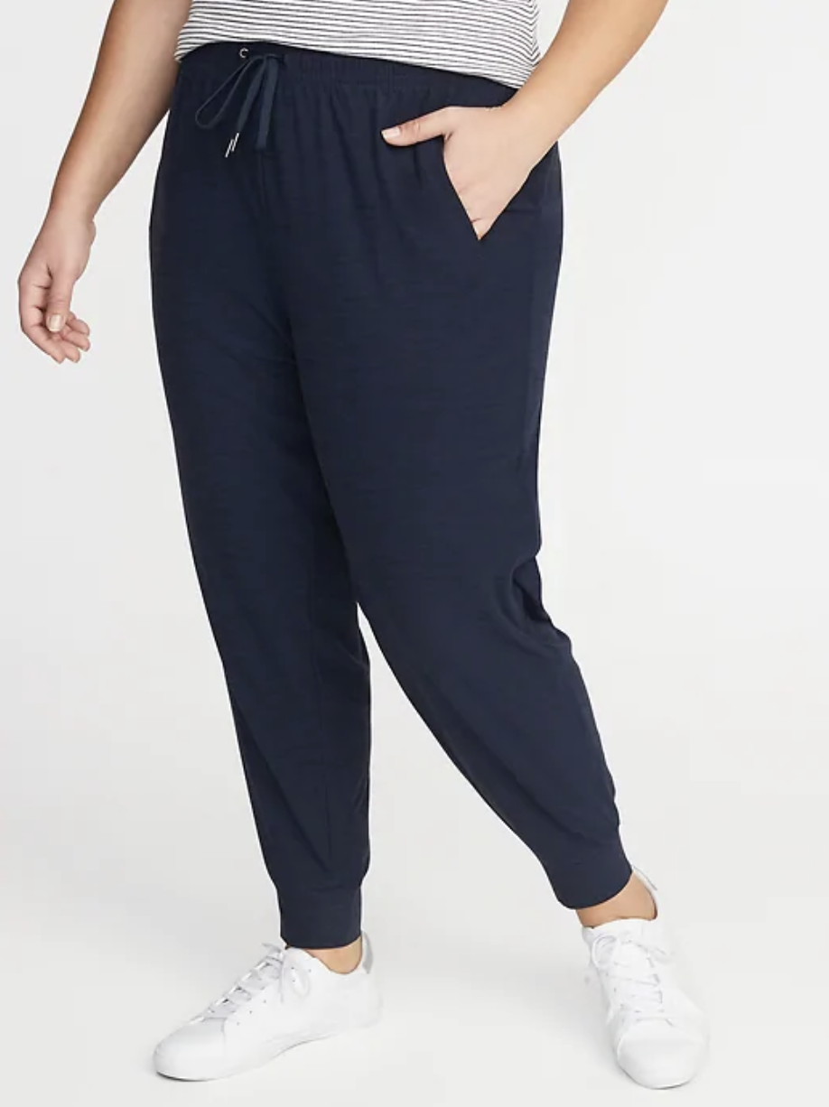 A model in navy blue joggers with a drawstring waist