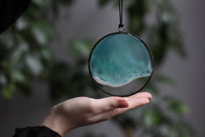 Resin sea art hanging off hand