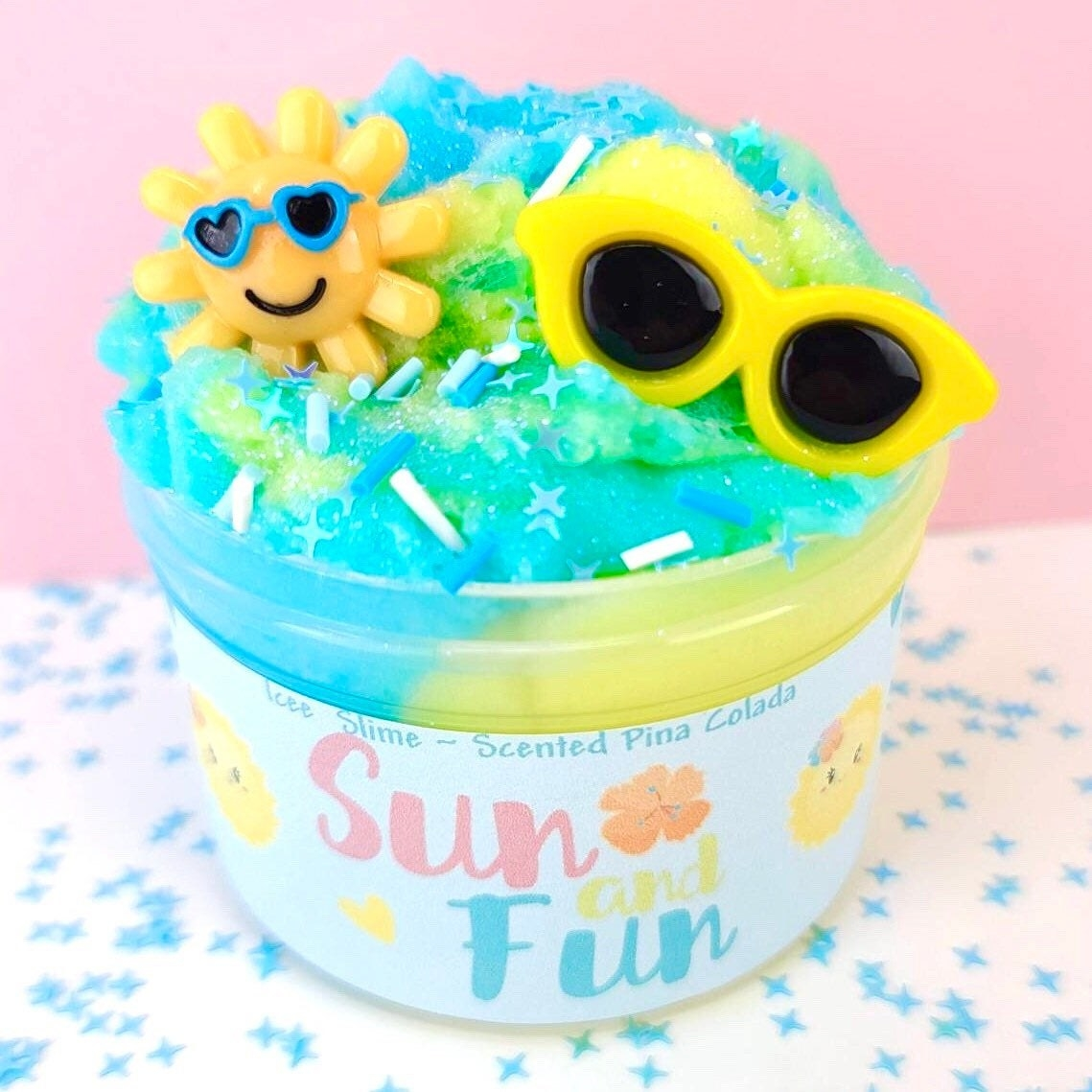 Container of slime with sun wearing sunglasses