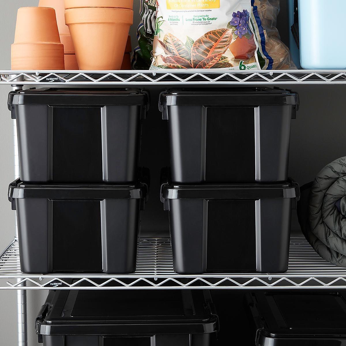 black bins with lids on a wire garage storage shelf
