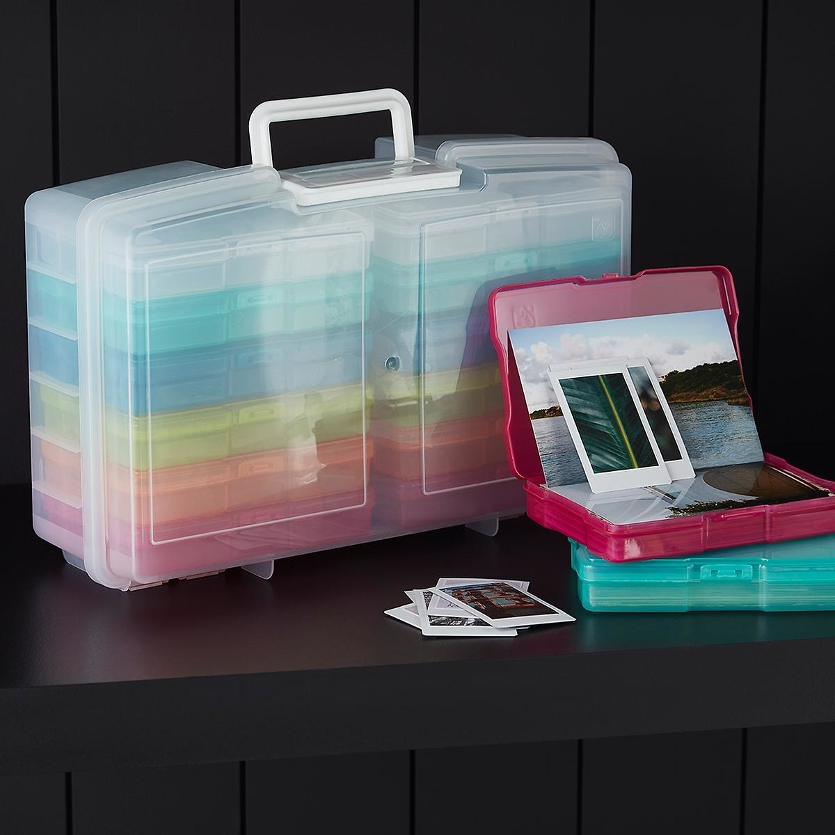 clear tackle box-like container with several smaller containers in different containers that hold stacks of 4 by 6 photos in it