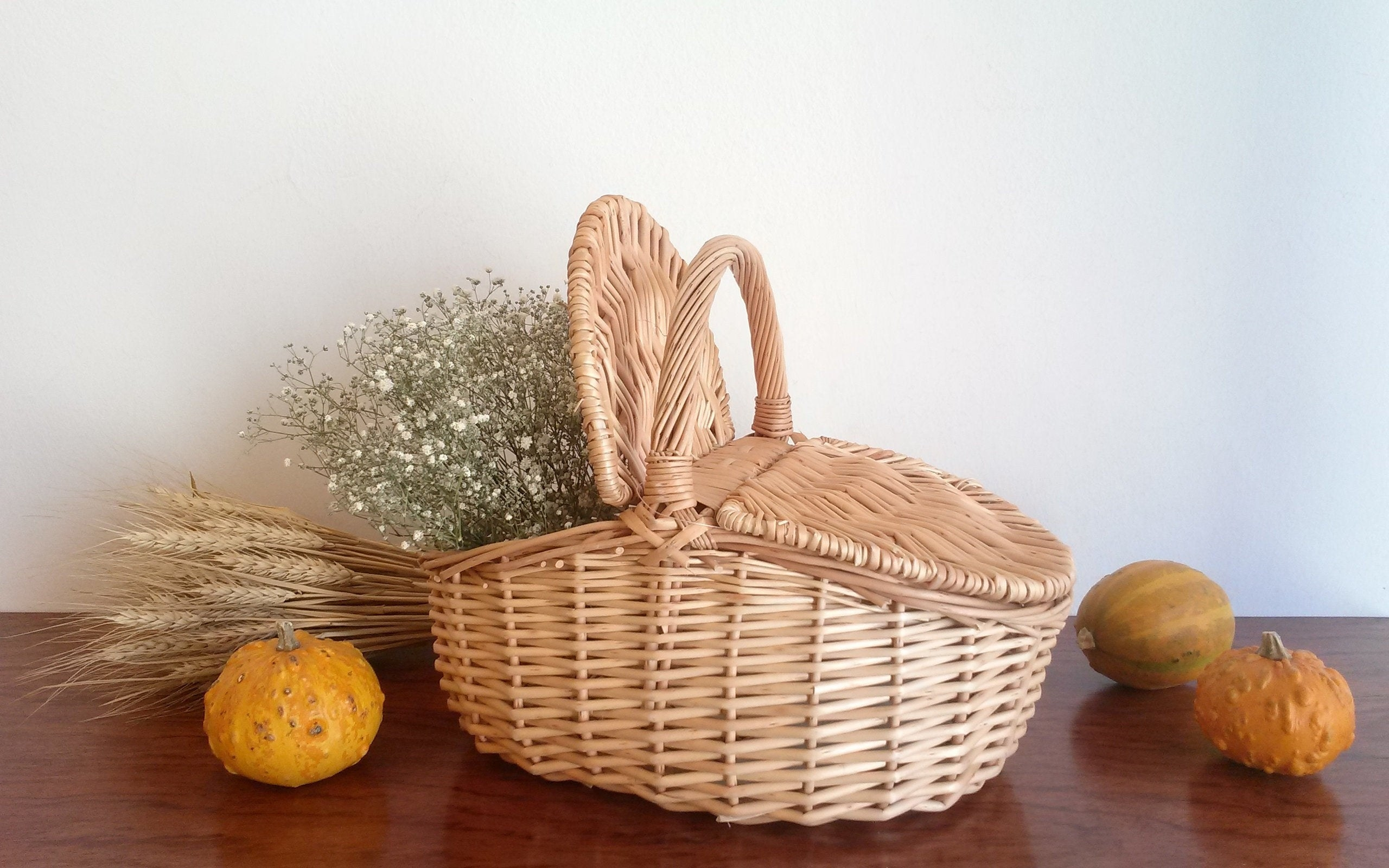 wicker picnic basket with flowers and gourds