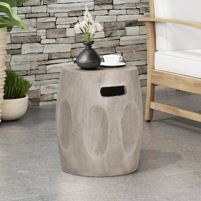 The cylindrical-shaped side table