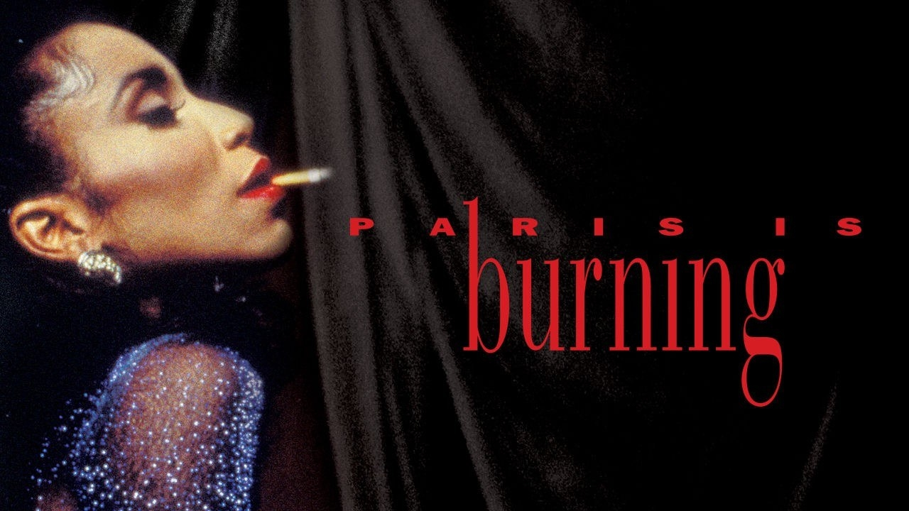 """The cover art for the documentary, """"Paris is Burning,"""" featuring a trans woman smoking a cigarette in an elegant gown"""